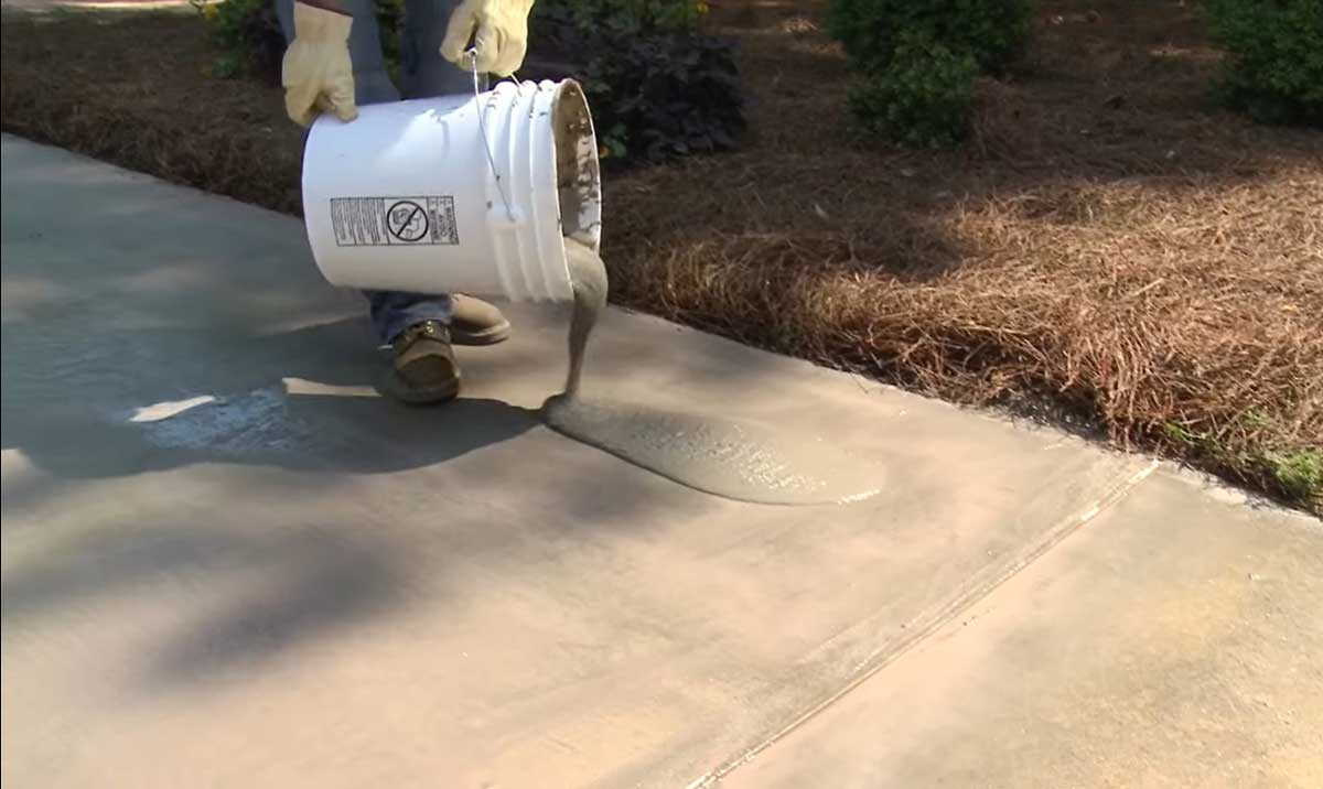 pour the resurfacer on the concrete